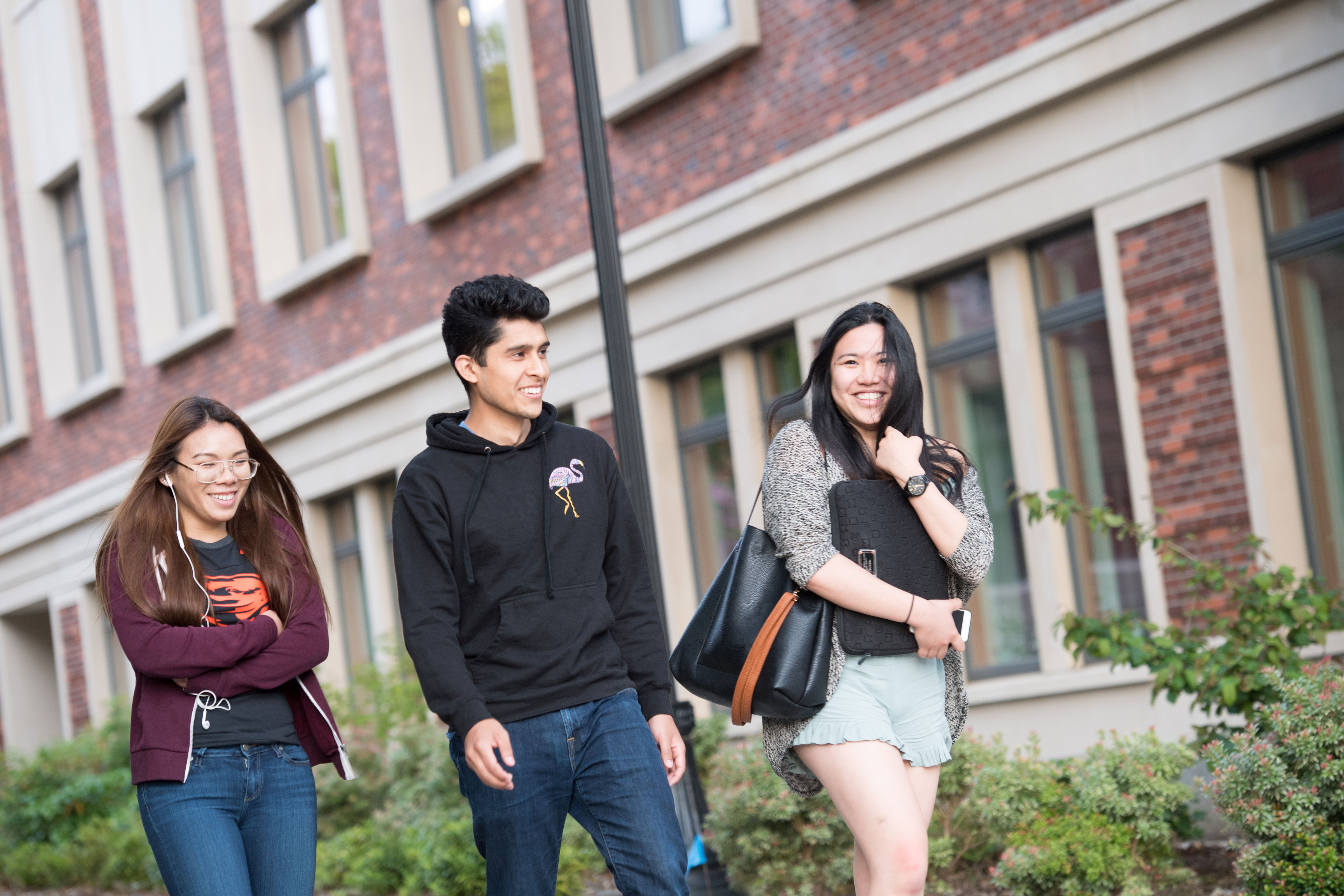 Students walk past the Student Experience Center.